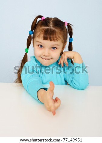 Funny little girl shows a finger - stock photo