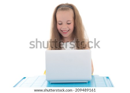 funny little girl using computer isolated on white background - stock photo