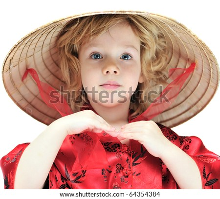 funny little girl wearing oriental costume - stock photo