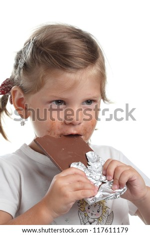funny little girl with chocolate