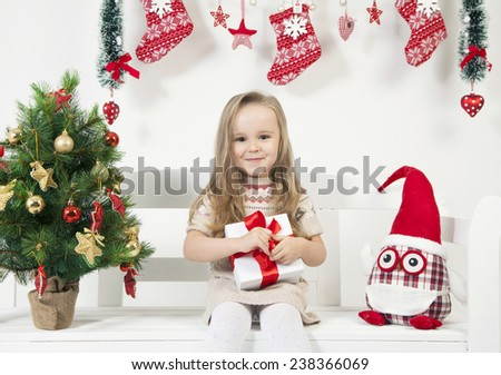 funny little girl with christmas decorations - stock photo