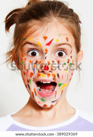 Funny little girl with colored face