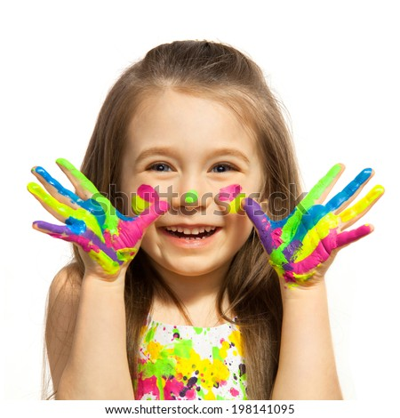 Funny little girl with hands painted in colorful paint. Isolated on white background. - stock photo
