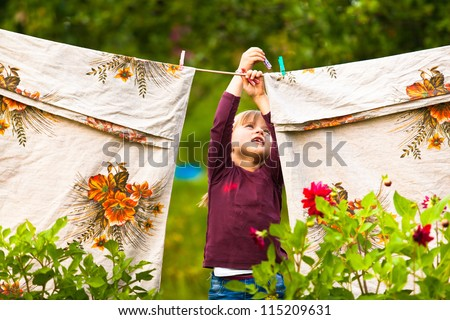 Funny little girl with the clothesline - stock photo