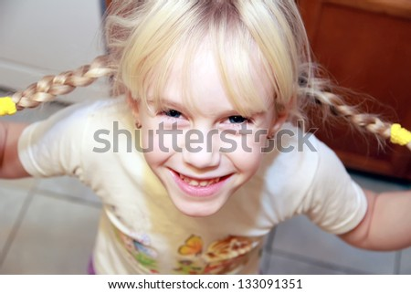 Funny little girl with two braids Looking up - stock photo