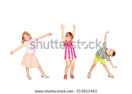 Funny little kids dancing. Isolated on white background