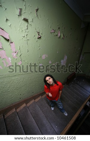 Funny little man in retro stairway - stock photo