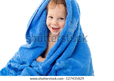 Funny little wet boy sitting in the towel, isolated on white - stock photo