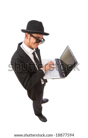 funny looking computer hacker with laptop on white - stock photo