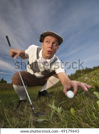Funny looking golfer cheating and moving the ball when no one sees. - stock photo