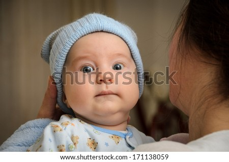 Funny looking toddler - stock photo