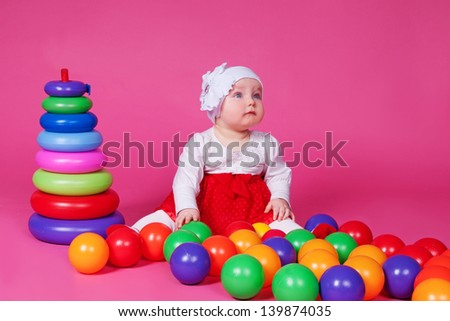 funny lovely baby girl little child in trendy dress. happy kid playing game. Cute adorable child baby American girl. Beautiful expressive laughing smiling baby infant toddler
