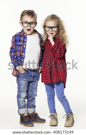 Funny lovely children.  fashionable little boy and girl in glasses, jeans, white t-shirts and plaid shirts. stylish kids in casual clothes in shocked. fashion children - stock photo