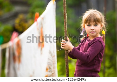 Funny lovely little five-year girl with clothespin. - stock photo
