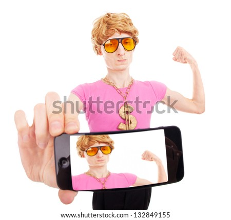 Funny macho guy taking a self portrait with smart phone - stock photo