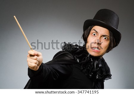 Funny magician wearing cylinder hat - stock photo
