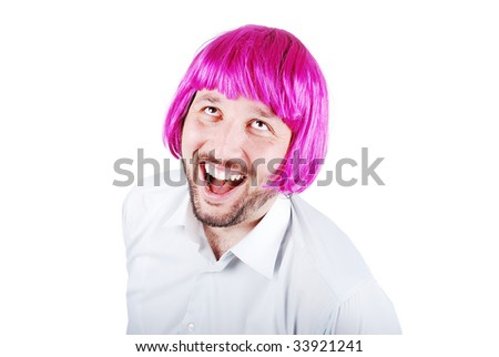 Funny male model with periwig on head - stock photo