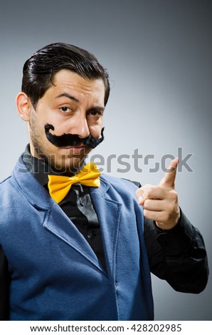 Funny man against dark background - stock photo
