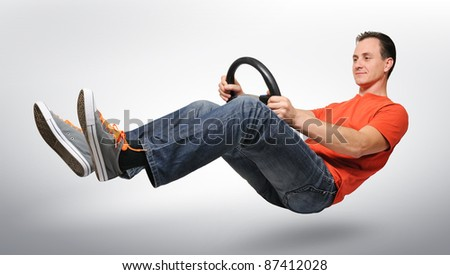Funny man car driver with a wheel, auto concept - stock photo