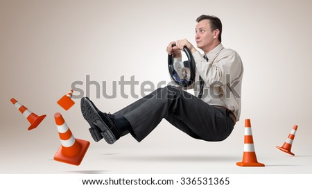 Funny man car driver with a wheel, concept exam for a driver's license - stock photo