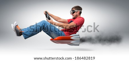 Funny man car driver with a wheel, concept of alternative transport  - stock photo