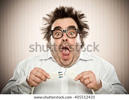 funny man get elettric shock in a vintage background - stock photo