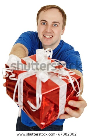 Funny man happily gives us a gift - stock photo