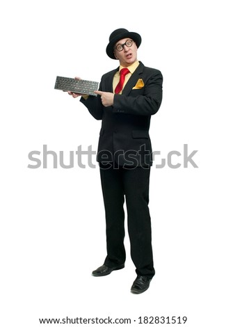 Funny man in black suit with keyboard