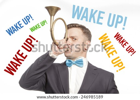 Funny man in blue bow tie blowing into the trumpet with multicolored title 'wake up'