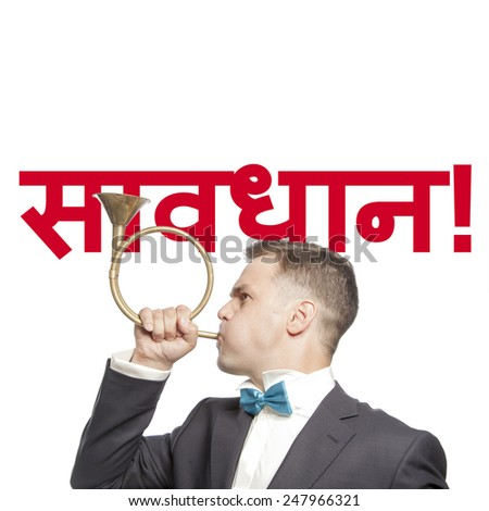 Funny man in blue bow tie blowing into the trumpet with title 'attention' hindi  language