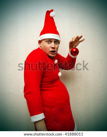 Funny man in red Santa Claus costume - stock photo
