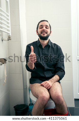 funny man in the toilet  - stock photo