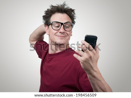 Funny man photographing himself on a smartphone - stock photo