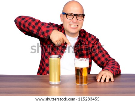 Funny man pointing on the beer - stock photo