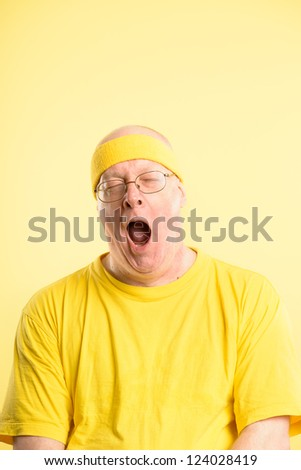funny man portrait real people high definition yellow background - stock photo