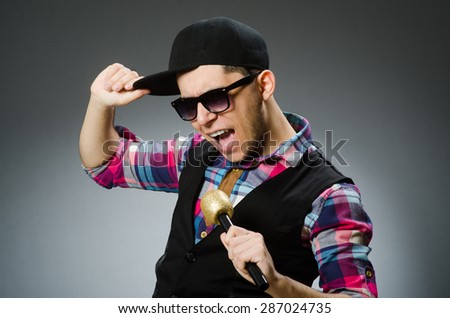 Funny man singing in karaoke - stock photo