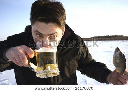 Funny man slake his thirst - stock photo