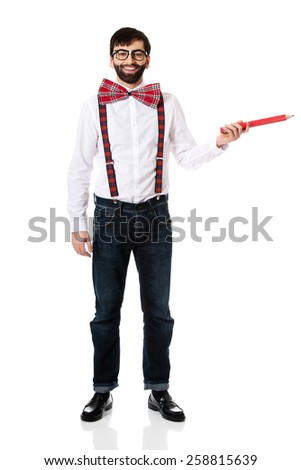 Funny man wearing suspenders pointing with big pencil. - stock photo