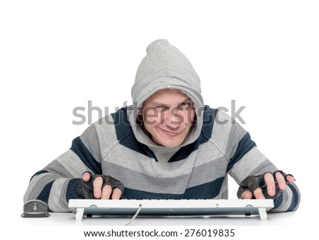Funny man with a keyboard in front of computer on white background - stock photo