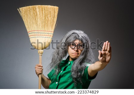 Funny man with brush and wig - stock photo