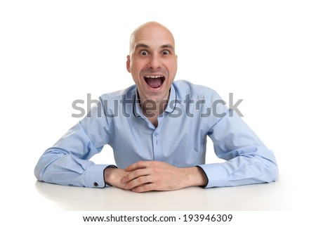 Funny man with crazy surprised look - stock photo