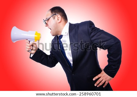 Funny man with loudspeaker  - stock photo