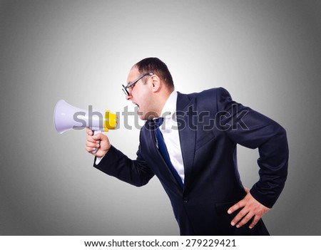 Funny man with loudspeaker on white