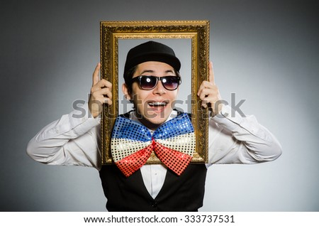 Funny man with picture frame - stock photo