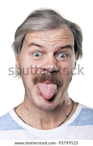 funny mature man shows tongue isolated on white background - stock photo