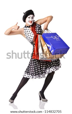 Funny mime in spotty dress holding shopping bags - stock photo