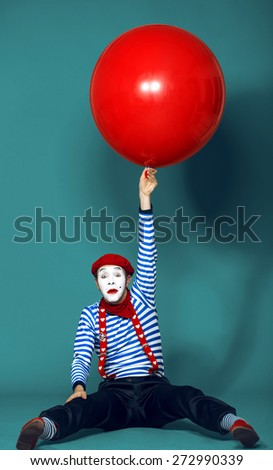 funny mime with red baloon - stock photo