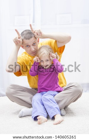 funny moments in father arm - stock photo