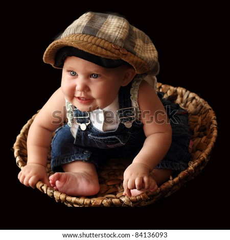 funny 8-month-old baby in the cap - stock photo