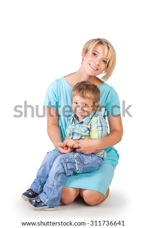 Funny mother and her son embracing isolated on white - stock photo